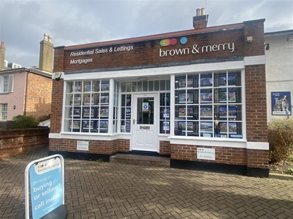 Brown & Merry Estate Agents Office lights up the High Street with photos of your property in a LED window display in a prime Town Centre location