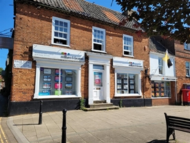 William H Brown Estate Agents in Swaffham, our Market Place office in it's prominent position!