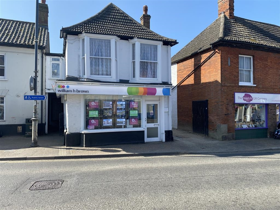 William H Brown Estate Agent in Watton are in a prominent location on the Main High Street  in the Town Centre with large LED lit window displays